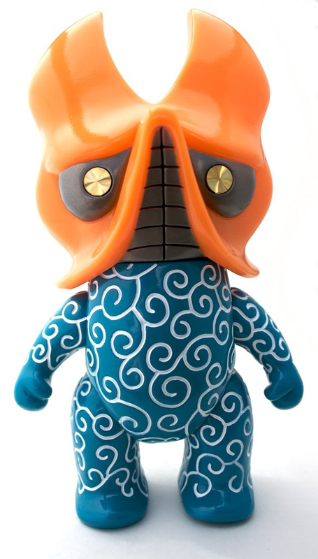 Blue vinyl body with white spray.  Orange soft vinyl pincher head and gold twinkle eyes.