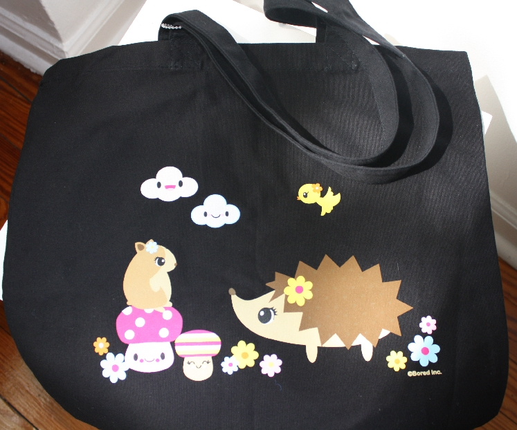 Black cotton canvas tote featuring a super cute hedgehog and hamster design.
