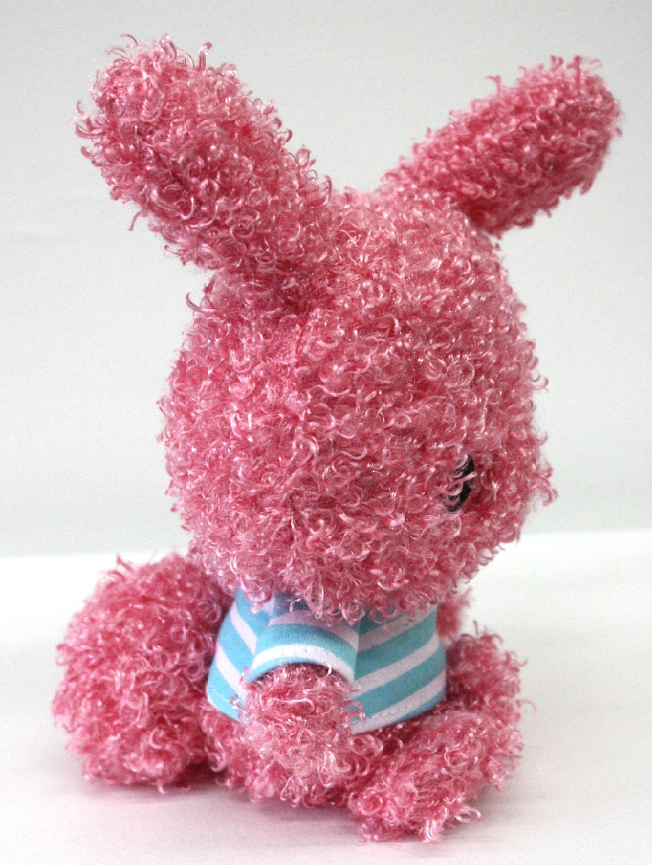 This adorable 6-inch (standing, with ears) pink bunny plush is sure to bring delight with it's cute striped shirt!