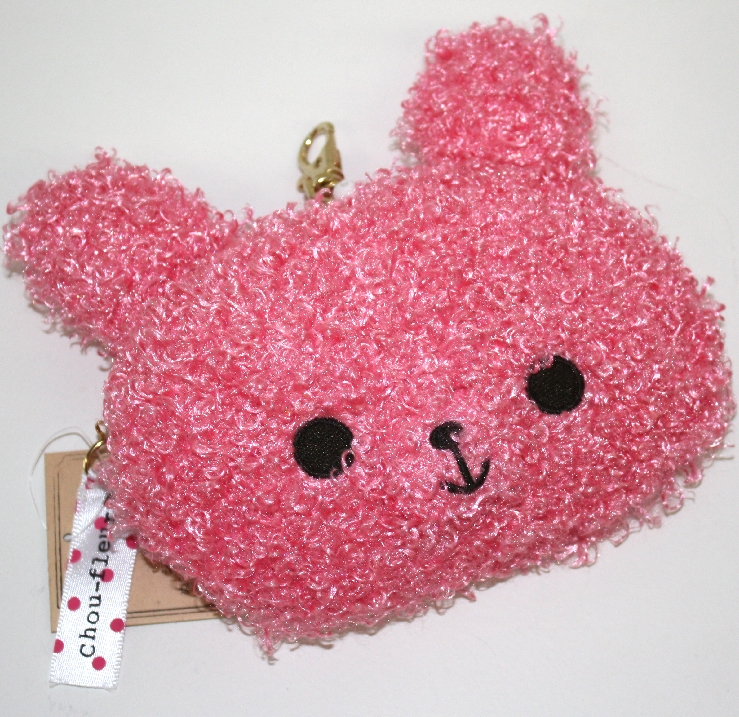 This adorable little pink purse is shaped like your favorite San-X character, Chou-Fleur. It includes a clear card holder on the back, a zip pouch lined with light blue and white stripes, and a key chain that expands and retracts when pulled for easy access!
