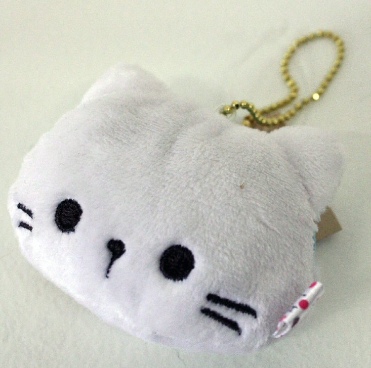 This listing is for one Pochette the Cat coin pouch.